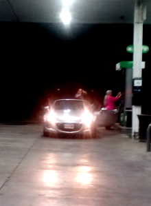 Jordan and my mom gassing up her car after our night drive.