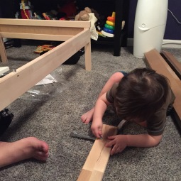 Kid helped build his new big boy bed.