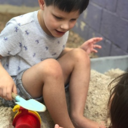 Playing in the sandbox their dad made for them
